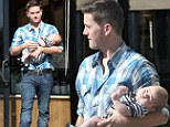Daddy duty: Twilight actor Jackson Rathbone dotes on two-month-old son Monroe during coffee run in L.A.