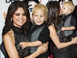 Selena Gomez kisses Jaxon Bieber, Canadian singer Justin Bieber's little brother, as she arrives on the red carpet for the gala presentation of the film Hotel Transylvania at the 37th Toronto International Film Festival
