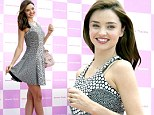 Out for a spin! Miranda Kerr twirls on her perfect pins in a form-fitting dress as she promotes fashion brand in Tokyo