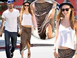 Showing her wild side! Behati Prinsloo steps out in a sexy leopard print skirt for a lunch date with Adam Levine