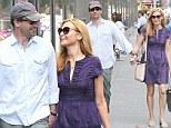 Madly in love! Jon Hamm and girlfriend Jennifer Westfeldt walk hand-in-hand in New York