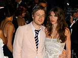 Cooking up a fortune: Jamie Oliver, pictured with his wife Jools, has come second in the list of the top 50 most valuable authors compiled by The Bookseller