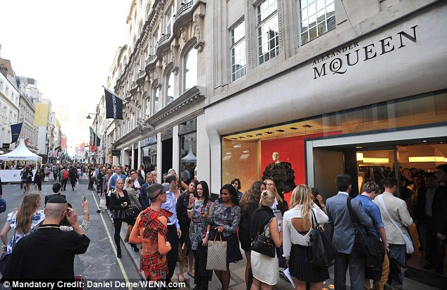 Savvy shoppers formed large queues outside Alexander McQueen as the streets were filled with music