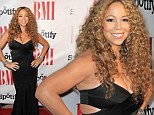 Well, she is the guest of honour! Mariah Carey shows off her curves in a tight cutaway dress at the Urban Music Awards