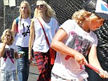 Putting themselves about! Gwen Stefani takes her boys on crazy golf adventure