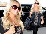 Worth the weight! Jessica Simpson continues to shed the pounds after signing multimillion dollar slimming contract