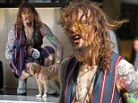 Dressing in the Dark-ness: Justin Hawkins rocks a garish pin striped look while walking his dog