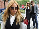 Rachel Zoe is smart and sophisticated in waistcoat-style dress as she takes a city stroll with husband Rodger