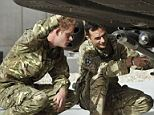 Britain's Prince Harry examines the 30mm cannon of an Apache