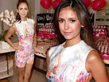 Artful attire: Nina Dobrev shows off her tanned pins in a paint-splattered top and shorts at Toronto Film Festival party