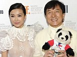 No wonder he's smiling: Jackie Chan was seen beaming as he posed with Yao Xingtong, left, and Zhang Lanxin at a special press event in Toronto