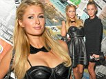 What a minx! Paris Hilton goes hell for leather in a racy leather bustier dress as she parties with sister Nicky