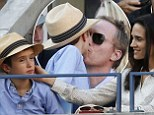 You're meant to be watching the tennis! Jennifer Connelly and Paul Bettany dote on son Stellan as they lead celebrities at the US Open