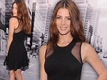 It never goes out of style! Ashley Greene keeps it classic in a little black dress for DKNY's New York Fashion Week show