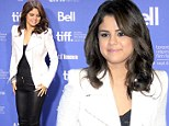 The lady is a vamp(ire): Selena Gomez goes for all out sex appeal in leather and lace at Hotel Transylvania photo call