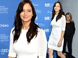 She's got the white stuff! Jennifer Lawrence continues her fantastic style streak at Silver Linings photo call