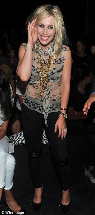 Stylish: Singer Natasha Bedingfield attended in a Chanel shirt
