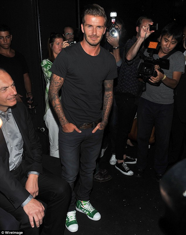 Going green: David Beckham kept it casual in trainers and jeans
