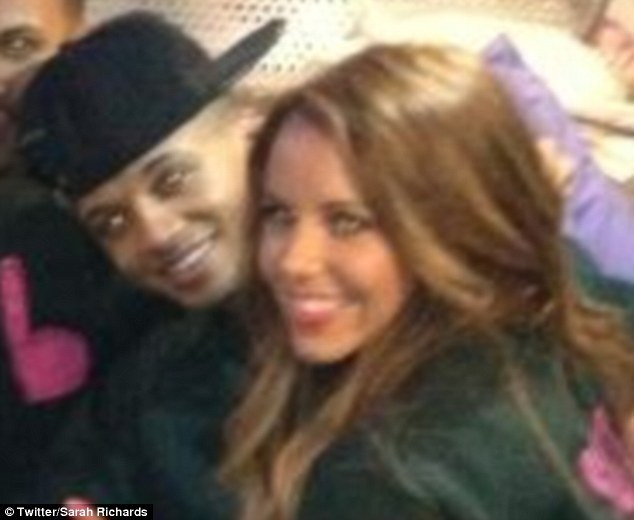 Loved up: Aston and Sarah hang out on the JLS tour bus