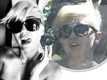 They came in handy! Miley Cyrus licks her lips as she shows off her new sunnies from her fiancé in Twitter snap before she wears them the next day to hide a hangover