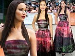Back to the dark side: Newly brunette Jennifer Lawrence is almost unrecognisable as she vamps it up at Toronto film premiere in Gothic-style gown