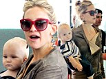 He's a Mummy's boy! Baby Bingham is the spitting image of his famous mother Kate Hudson as they jet out of Toronto
