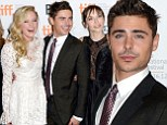 He knows how to work a pout! Zac Efron shows off his photo face at the At Any Price premiere in Toronto