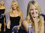 The thigh's the limit! Kate Hudson shows off her super-toned legs in sexy little black dress with daring split