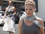 Having a Marilyn moment! Katherine Heigl dons pleated white skirt and showing off her curves in tight top