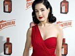 Simply red: Dita Von Teese looked ravishing as she arrived at The Arts Club, in London, last night for her handbag launch