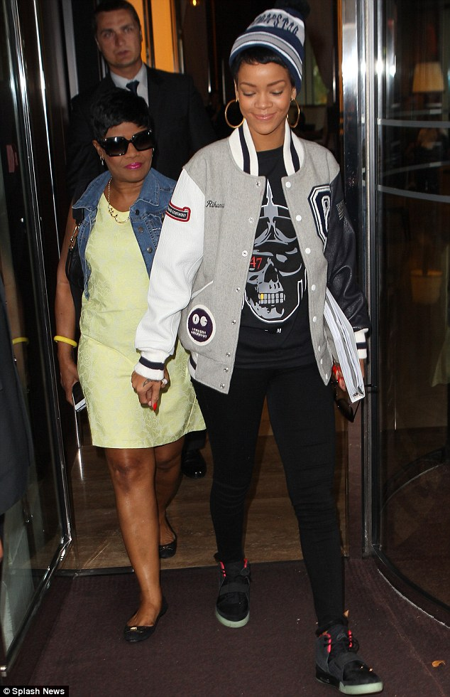 Mummy's Girl: Rihanna was pictured this morning (Monday) hand in hand with her mother Monica leaving her London Hotel as she headed to Heathrow airport