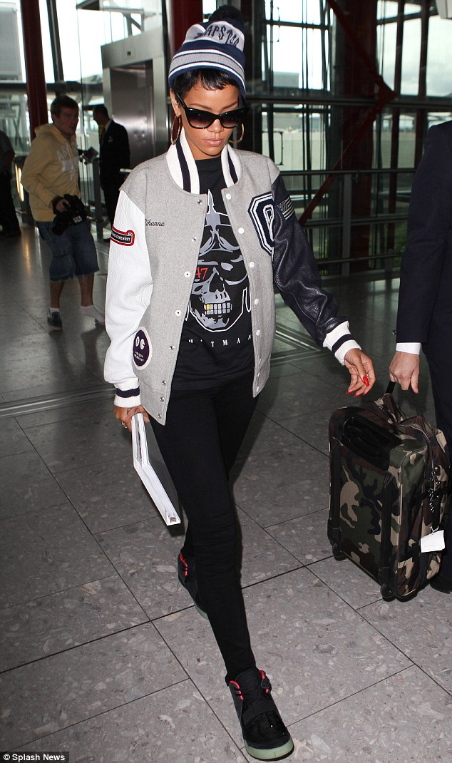 Home time: Rihanna looked a little glum as she arrived at the airport