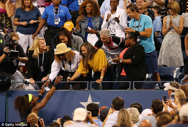 Victory lap: Serena immediately ran over to her mother (seen wearing a hat) in the stands, as her sister Venus looked on from the third row (back center right) and Anna Wintour (back right) clapped