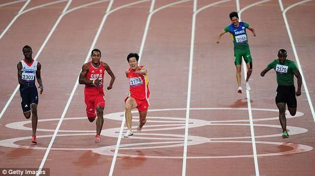 A devastated Yohansson Nascimento, second from right, pulls up with a leg injury in the Men's 100m T46 final and his rivals race away from him