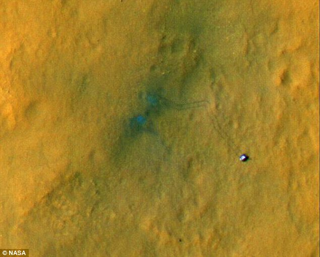 Tracks: NASA has released images of Curiosity setting off from its landing site across the red planet