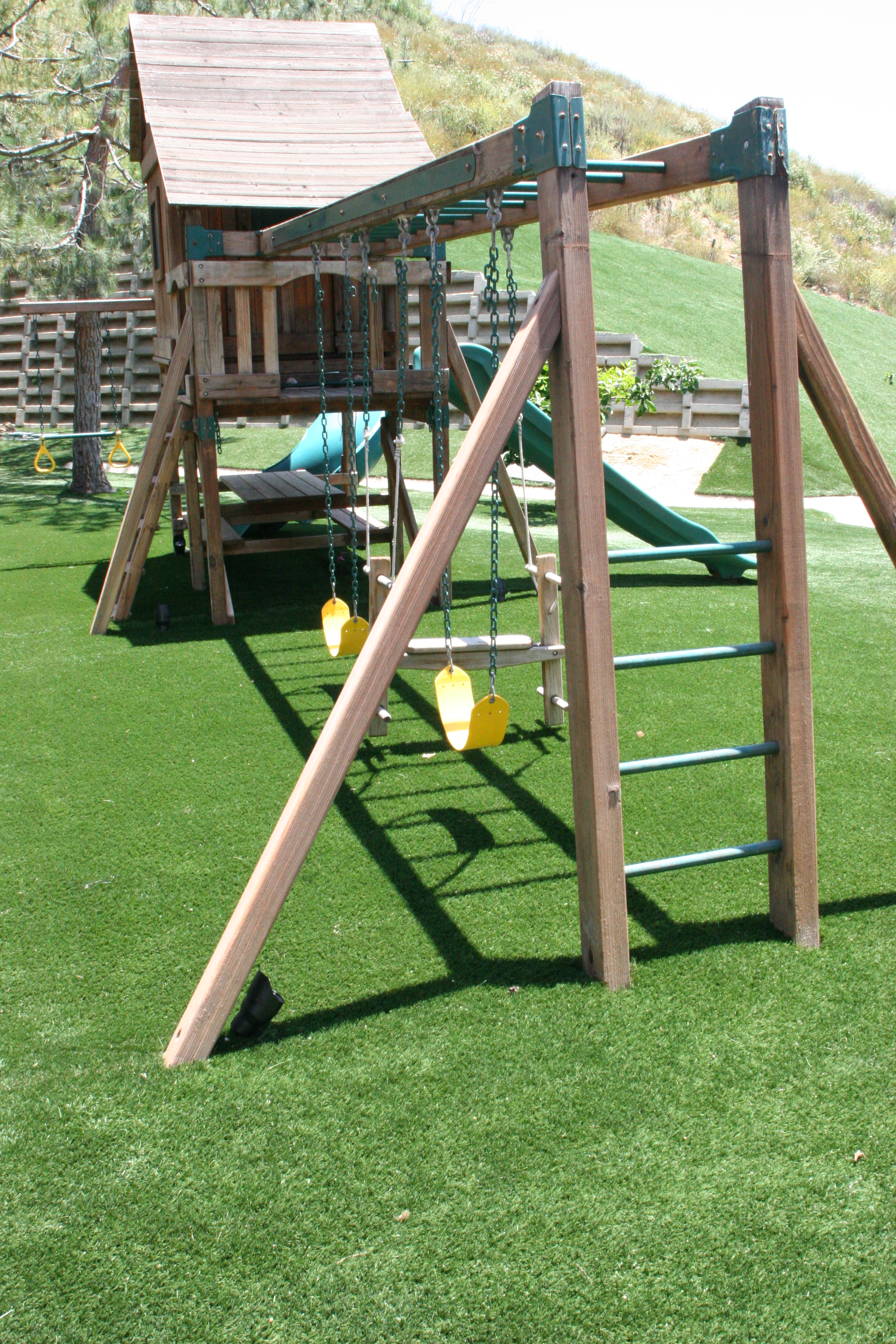 ask your wife for Sacramento Artificial Grass made for kids saftey with your back yard Playgrounds  and your putting green...