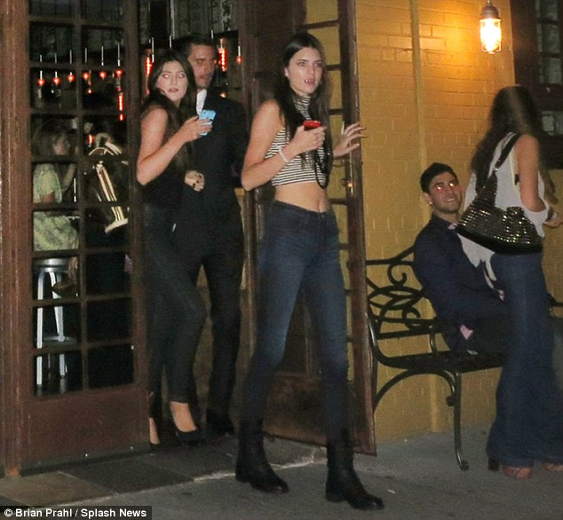 Playing big brother: Scott was tasked with looking after Kourtney's sisters Kendall and Kylie Jenner in New York on Saturday night