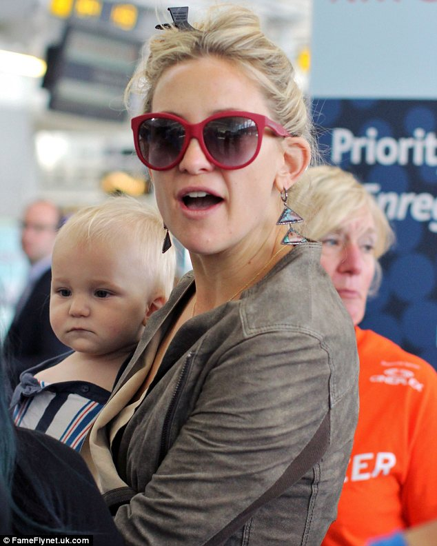 The apple doesn't fall far from the tree: Kate Hudson carried her mini-me son Bingham around Toronto airport today