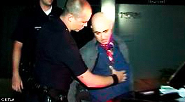 Under arrest: Jason Luis Rivera is arrested by LAPD after bing found on the property of Miley Cyrus in Studio City