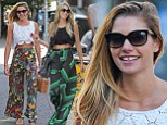 Jessica Hart is all smiles as she walks her dog in the East Village, NY