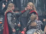 There's two of them! Chris Hemsworth was joined on set by a stunt double as he got to work on the Thor sequel today (Tuesday)