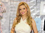 Glowing mother-to-be: Holly Madison cradled her growing baby bump as she announced and promoted her New Pet Line, Lucky Pet Products, at the Superzoo Convention in Las Vegas today