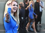 Electrifying: Britney Spears waves to fans at a special screening of The X Factor in Hollywood on Tuesday night