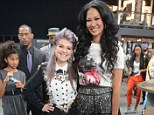She could use some higher heels! Kelly Osbourne comes up short as Kimora Lee Simmons towers over her at Fashion Week