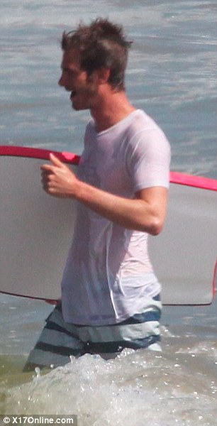 Sporty: The birthday boy was seen playing with a beach ball and a boogie board