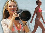 She's picture perfect! Bikini girl Erin Heatherton gets behind the camera for a change as she takes charge on photo shoot
