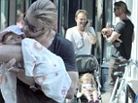 Not good Neighbours: Doting dads Chris Hemsworth and Jason Donovan are oblivious to each other during day out with their babies