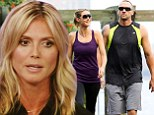 Heidi Klum goes for a morning jog around Manhattan with her bodyguard on August 11th.