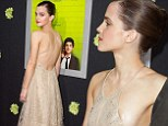 Hardly a wallflower! Emma Watson suffers a wardrobe malfunction as her backless dress proves slightly TOO revealing at premiere