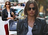Red hot to trot! Irina Shayk highlights her model pins as she goes shopping in Paris